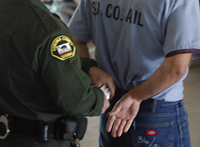 Image of inmate being handcuffed